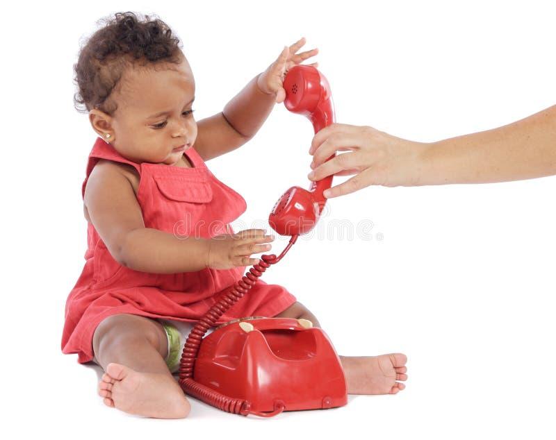 Bebé com telefone imagens de stock
