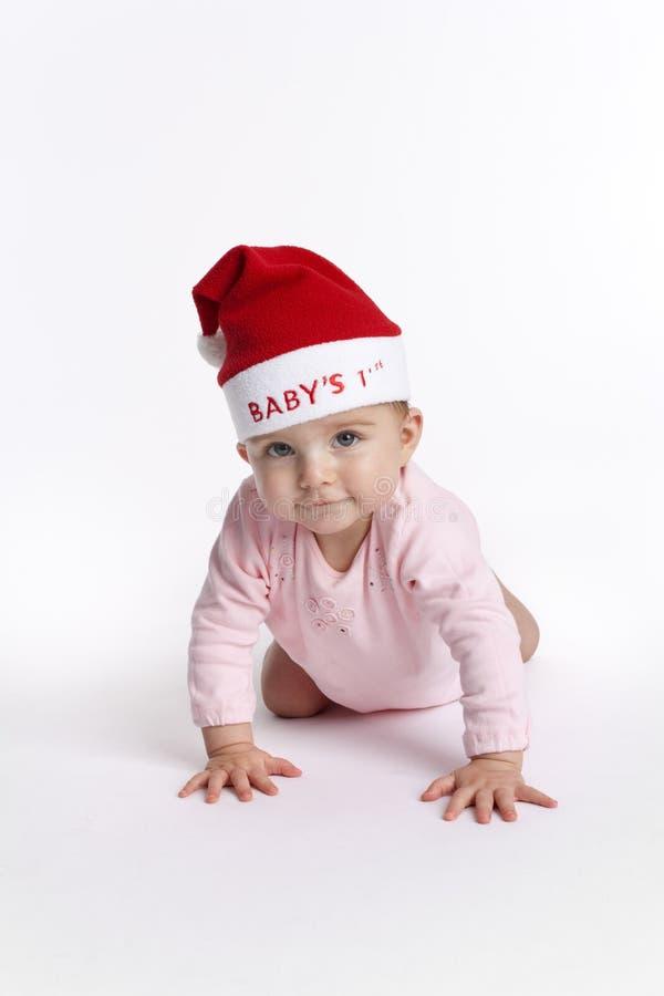 Bebé con el sombrero de la Navidad foto de archivo