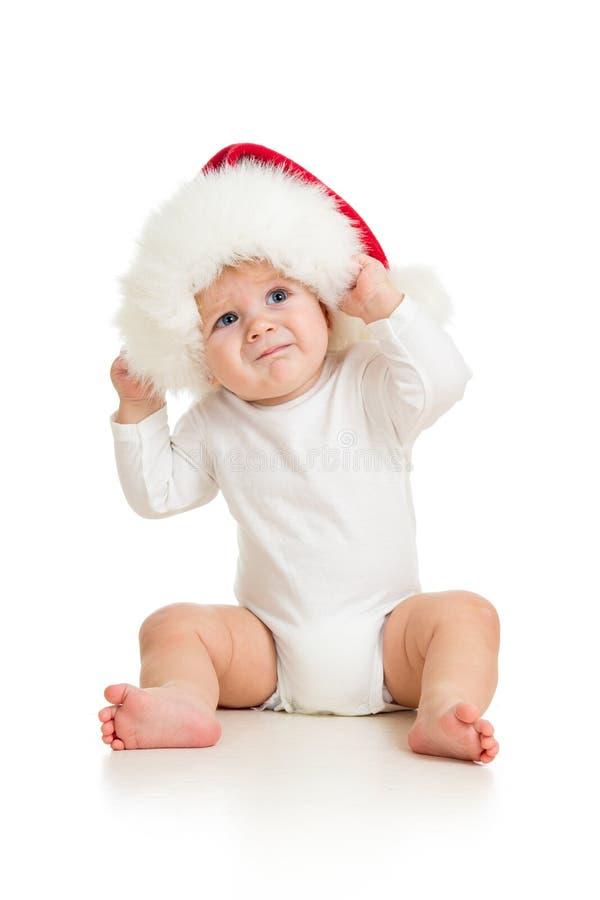 Bebé con el sombrero de Papá Noel foto de archivo libre de regalías