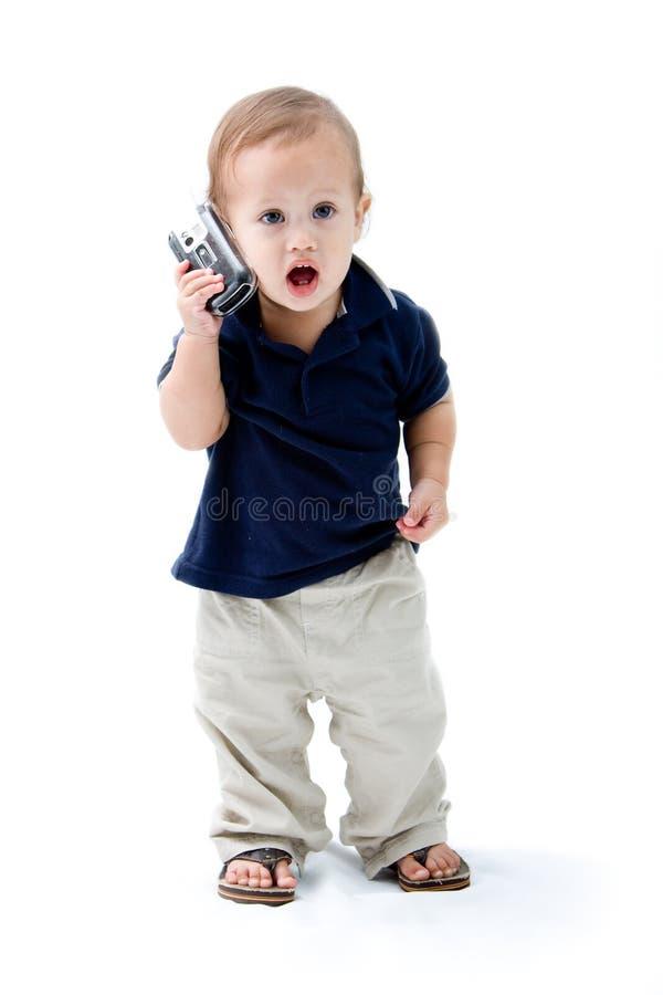 Bebé con el teléfono fotografía de archivo
