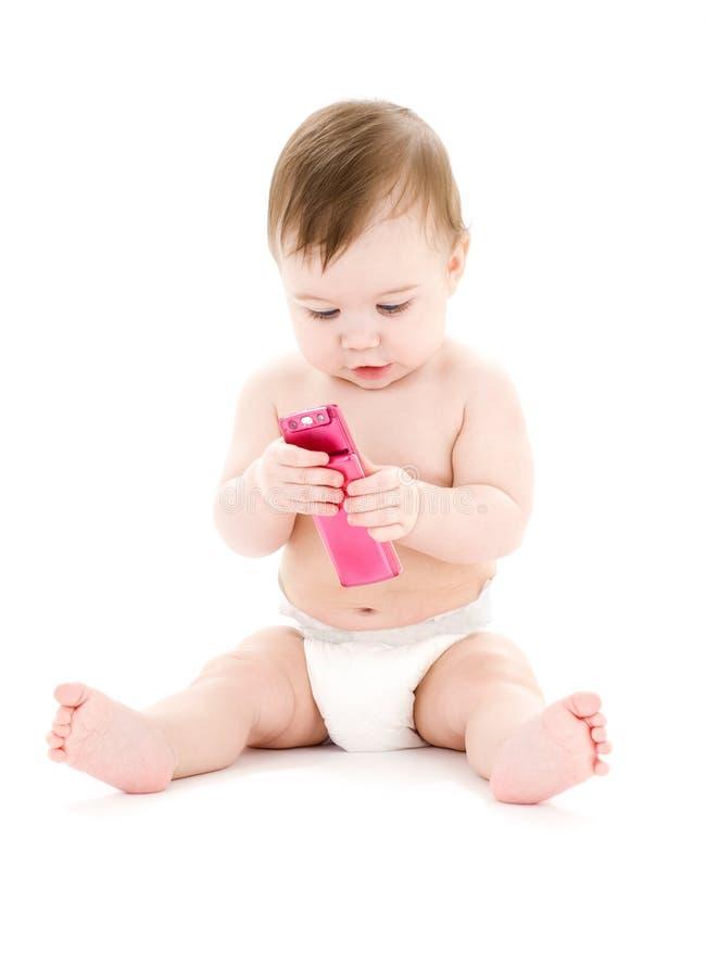 Bebé con el teléfono celular foto de archivo libre de regalías
