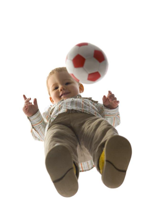 Bebé con la bola imagenes de archivo