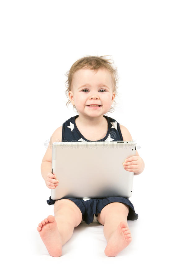 Bebé con la tablilla foto de archivo libre de regalías