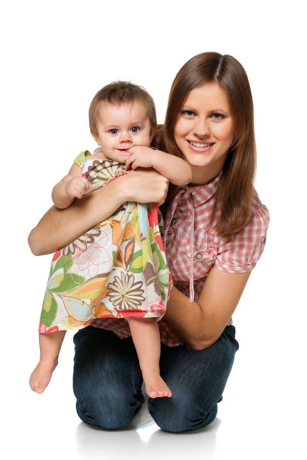 Bebé con su madre foto de archivo libre de regalías