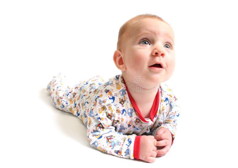 Bebé curioso imagenes de archivo
