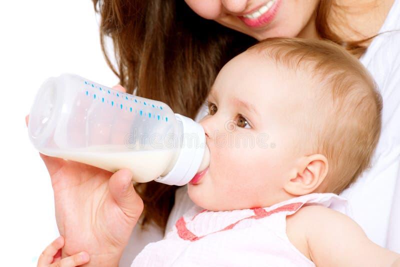Bebé de alimentación imagen de archivo