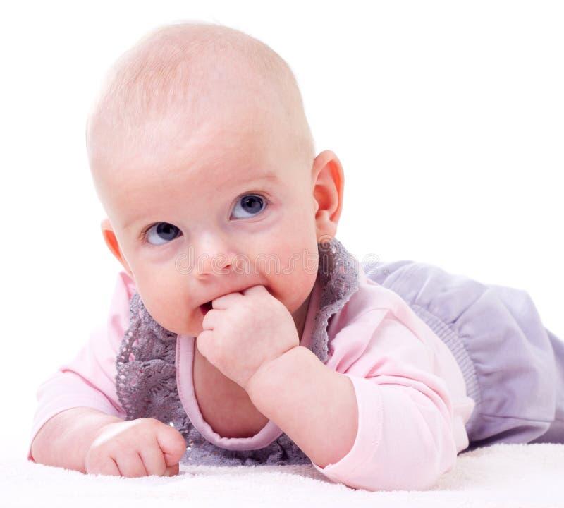 Bebé de la dentición imagenes de archivo