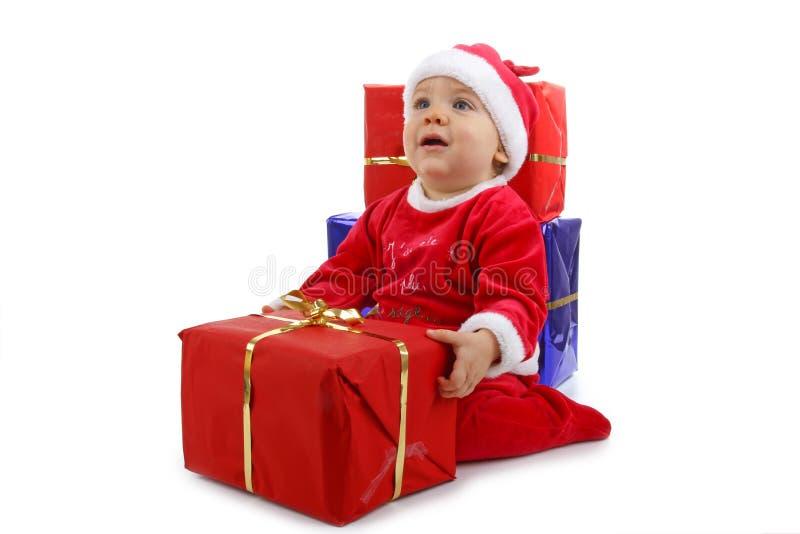 Bebé de la Navidad con el presente imagen de archivo