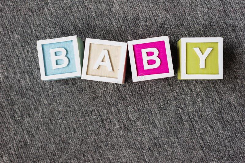 Bebé de la palabra hecho de los cubos de la letra foto de archivo