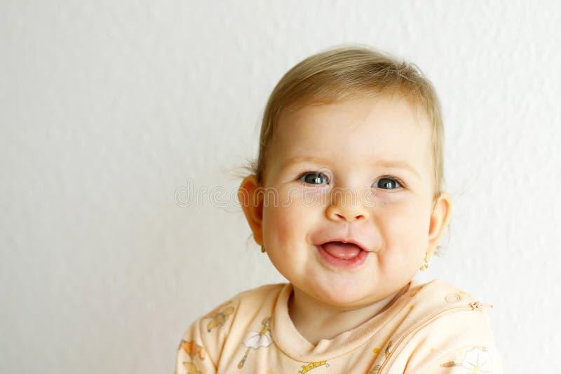 Bebé de risa fotografía de archivo