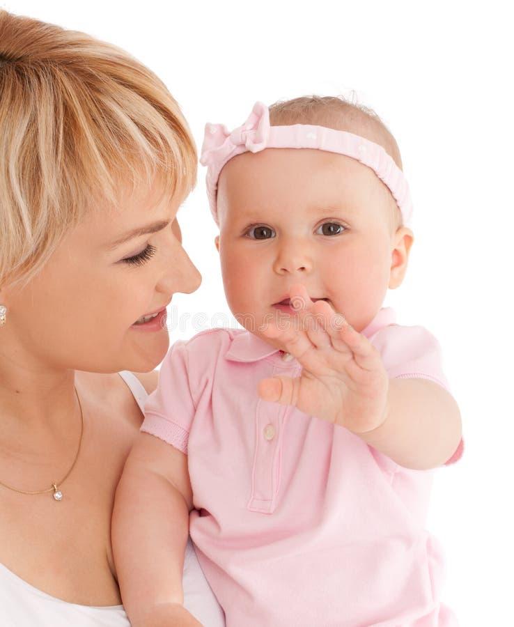 Bebé del asimiento de la madre fotografía de archivo libre de regalías