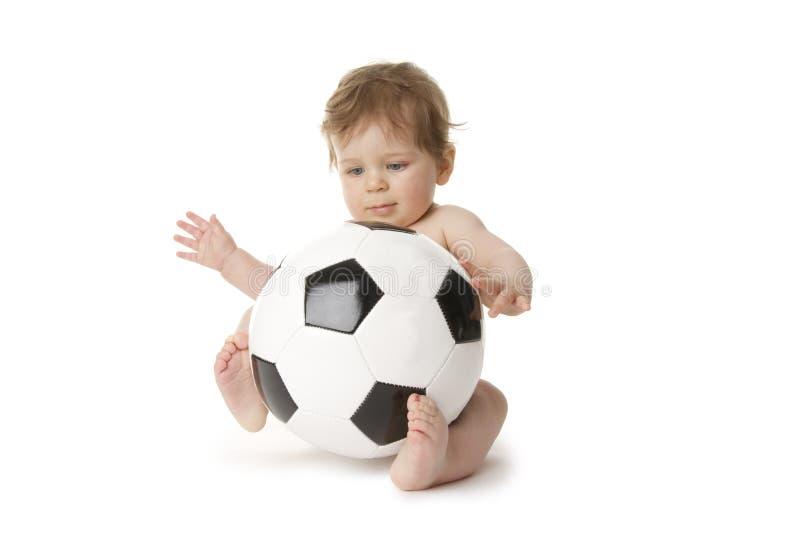Bebé del fútbol imagen de archivo