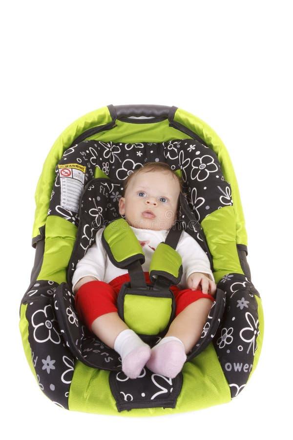 Bebé en asiento de coche imagen de archivo