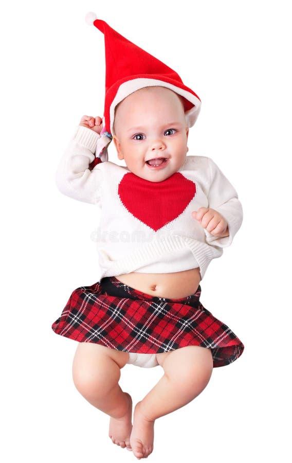 Bebé en el sombrero de santa del traje de la Navidad aislado fotos de archivo libres de regalías