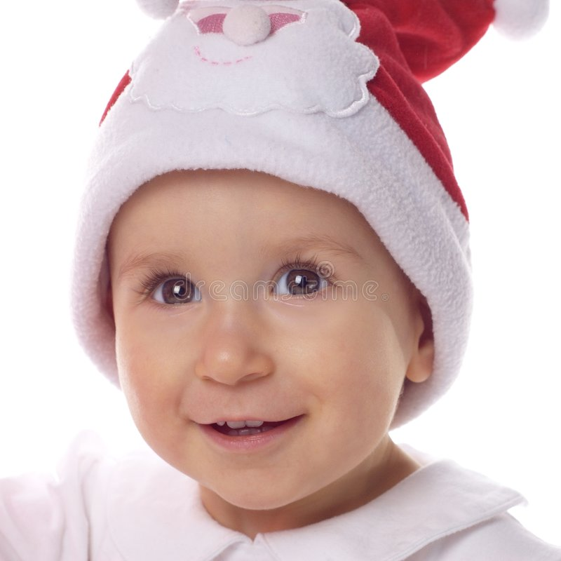 Bebé en el sombrero grande de Papá Noel foto de archivo