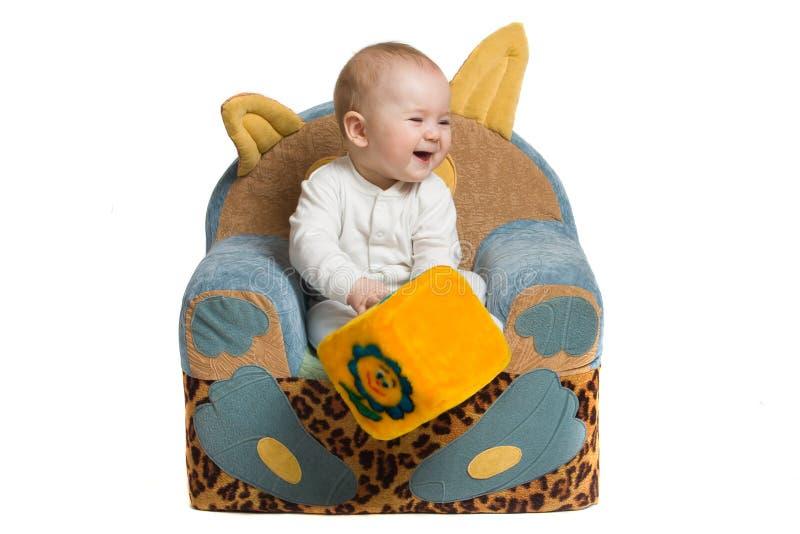 Download Bebé en una butaca. foto de archivo. Imagen de blanco - 7276360