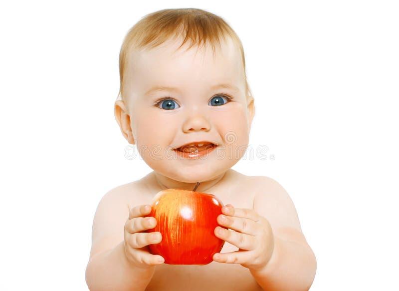 Bebé encantador con la manzana foto de archivo