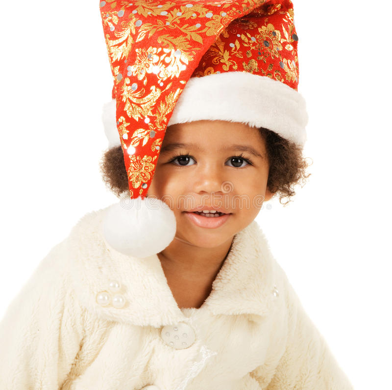 Bebé encantador en sombrero y piel de la Navidad imagenes de archivo