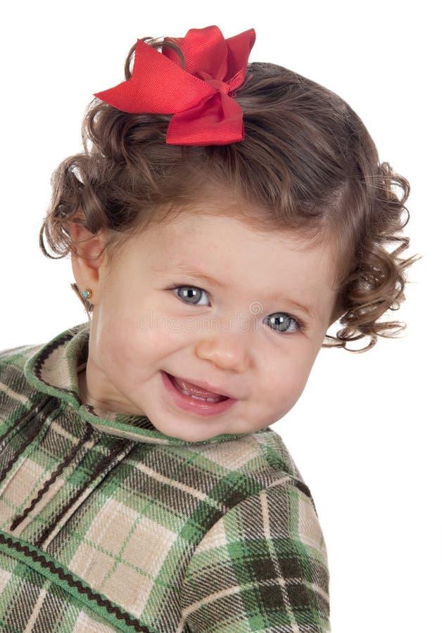 Bebé engraçado com laço vermelho imagem de stock royalty free