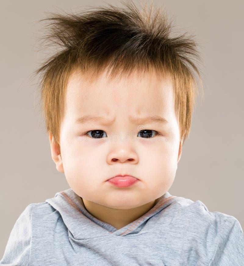 Bebé enojado fotografía de archivo