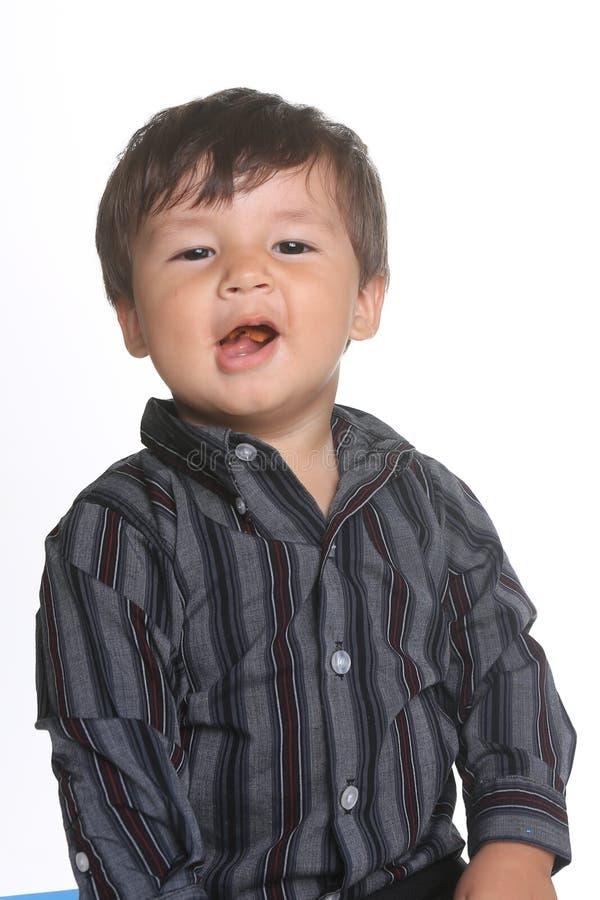 Bebé expresivo adorable feliz en un fondo blanco fotografía de archivo