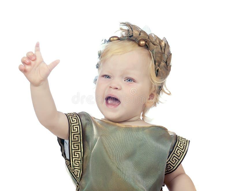 Bebé falador em um vestido extravagante grego fotos de stock royalty free