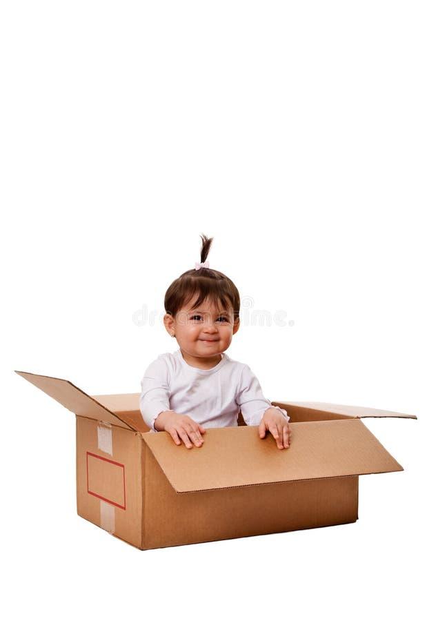 Bebé feliz en rectángulo de la sorpresa imagenes de archivo