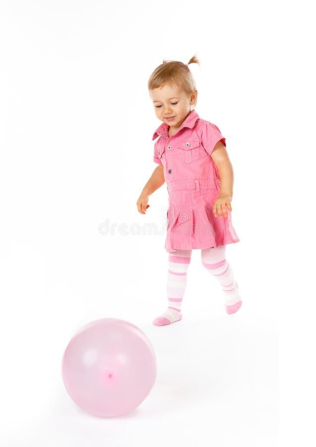 Bebé lindo con impulso imágenes de archivo libres de regalías