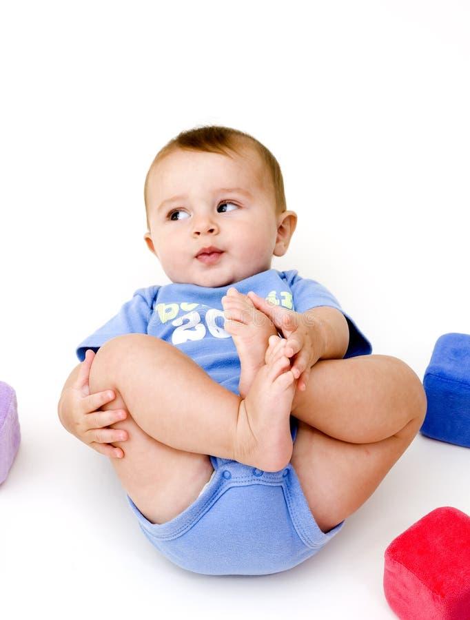 Bebé lindo con los juguetes imagen de archivo libre de regalías