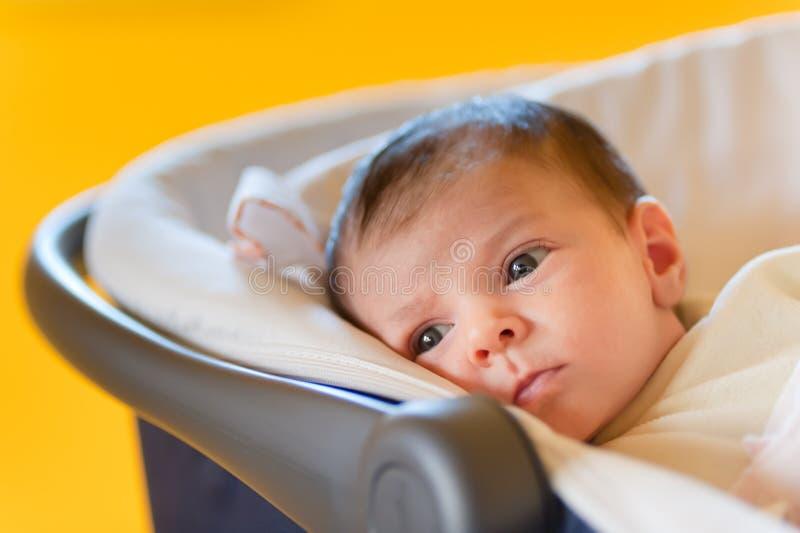 Bebé lindo en un cochecito fotografía de archivo libre de regalías