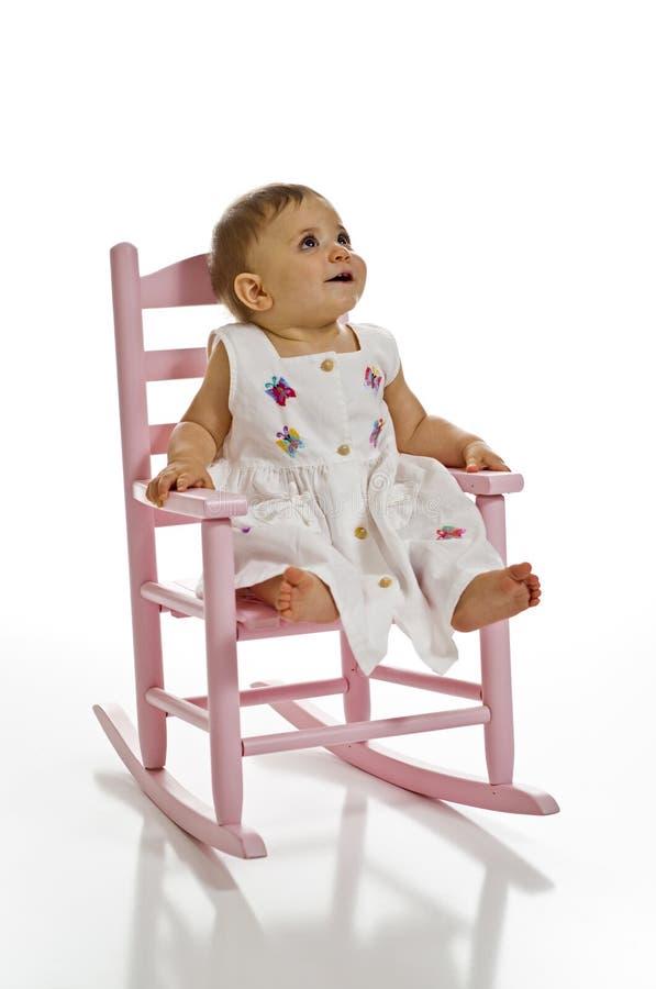 Bebé na cadeira de balanço foto de stock