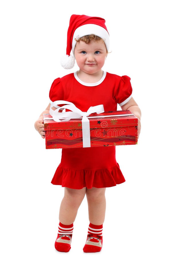 Bebé no presente de Natal da terra arrendada do chapéu de Santa foto de stock