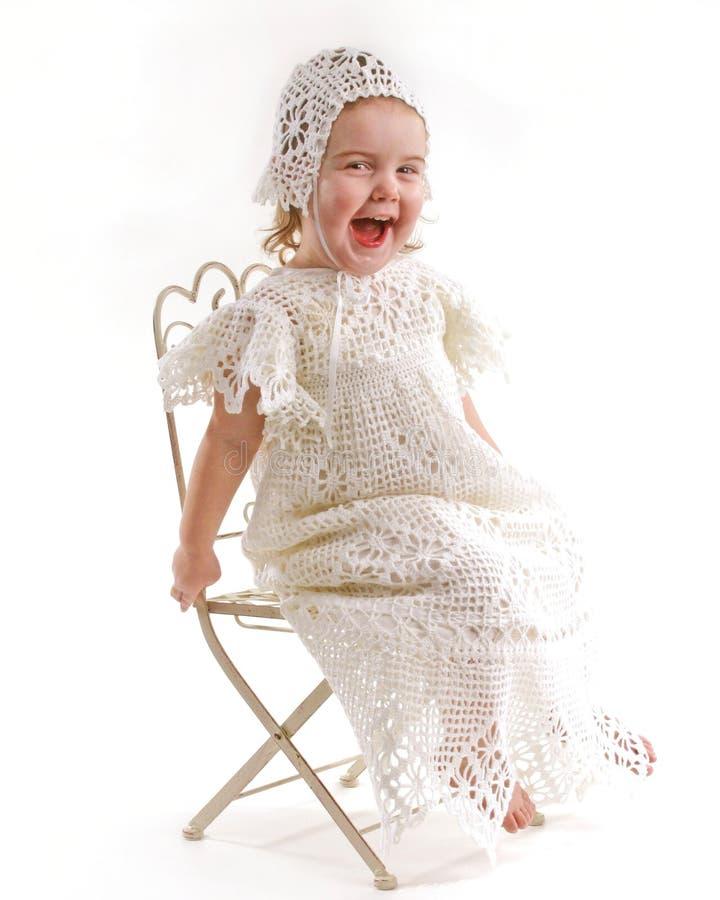 Bebé no vestido do batismo fotografia de stock