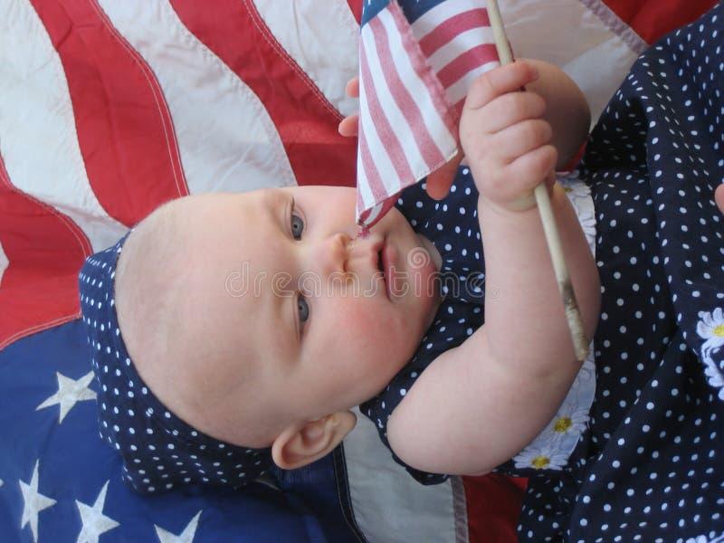 Bebé patriótico con el indicador foto de archivo