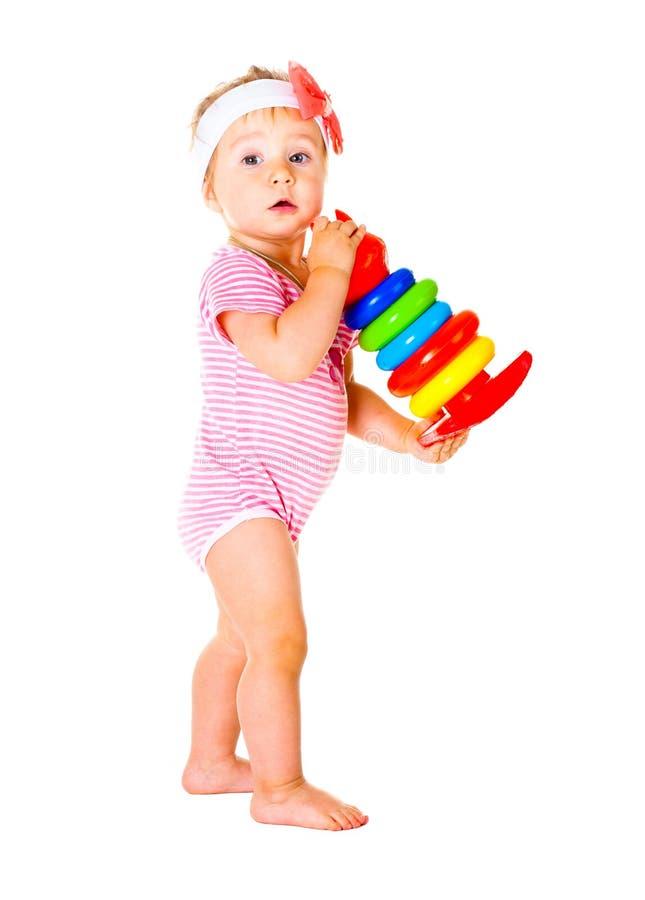Bebé que juega en las bolas fotografía de archivo