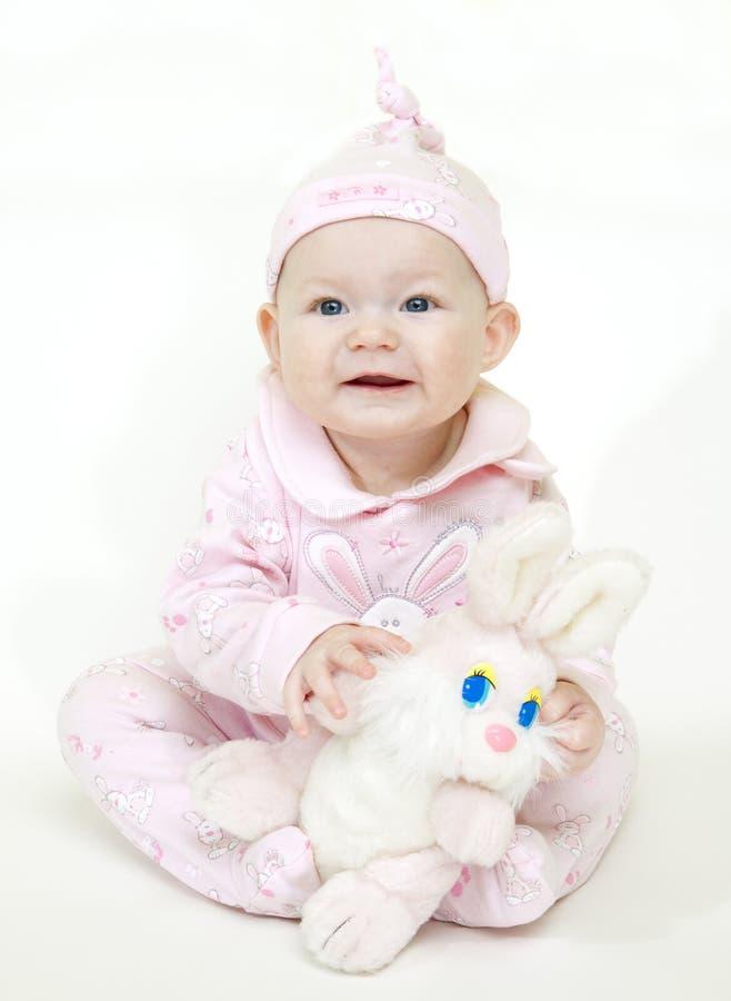 Bebé que se sienta fotografía de archivo