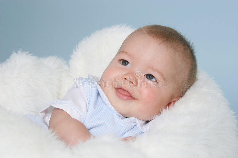 Bebé sonriente imagenes de archivo