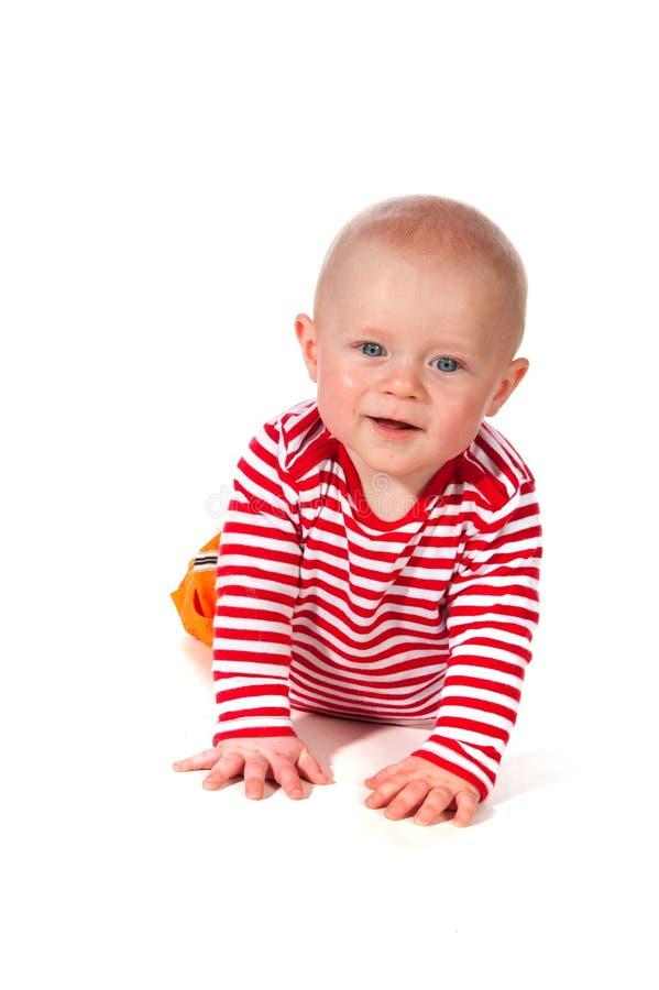 Bebé sonriente cómodo imagenes de archivo