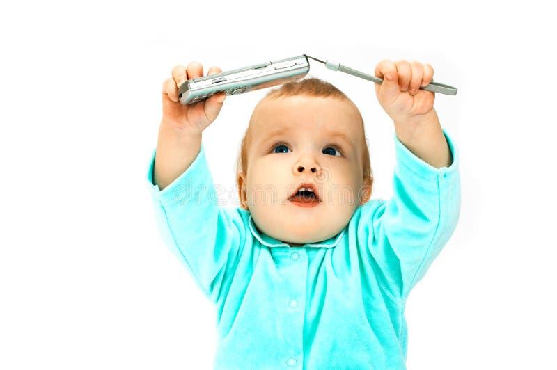 Bebé y celular imagen de archivo libre de regalías