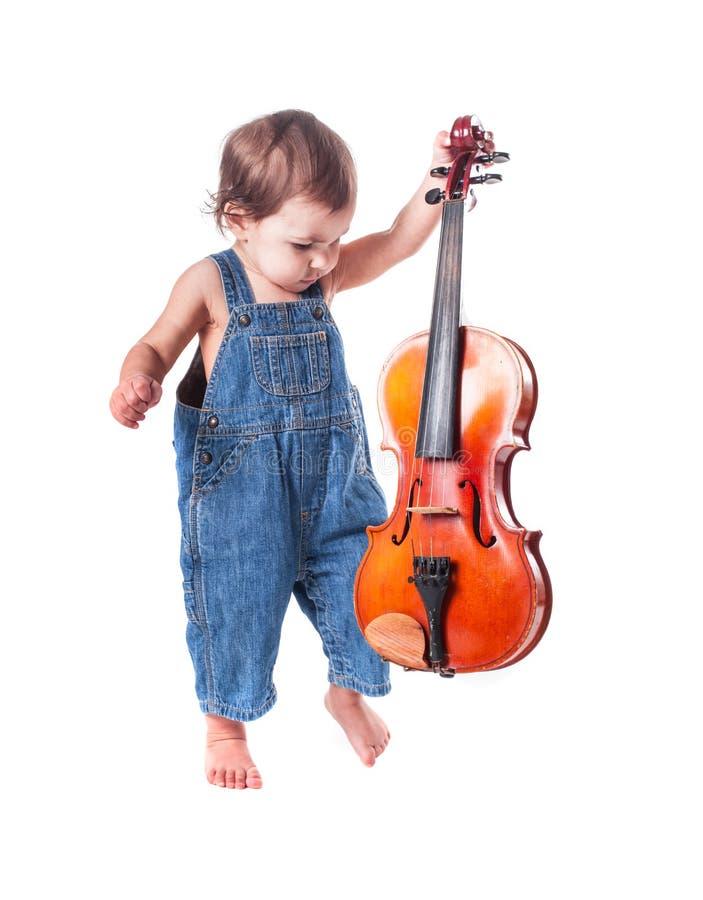 Bebé y violín fotos de archivo