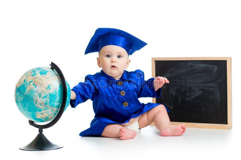 Bebê acadêmico com globo e quadro fotografia de stock royalty free