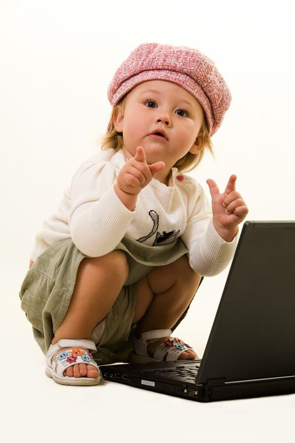 Bebê adorável com portátil foto de stock royalty free