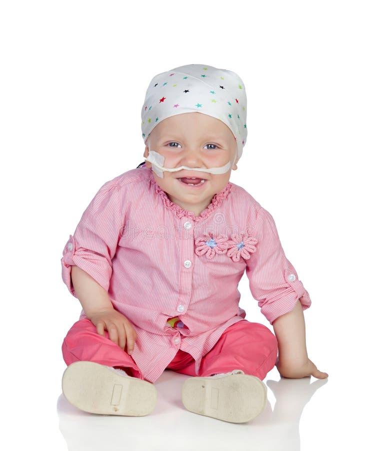 Bebê adorável com um lenço que bate a doença imagens de stock