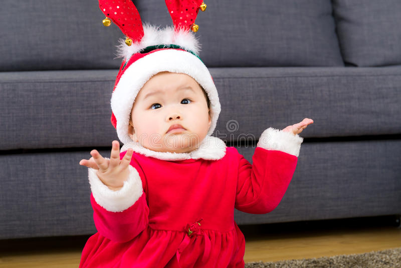Bebê asiático com molho do Natal foto de stock royalty free