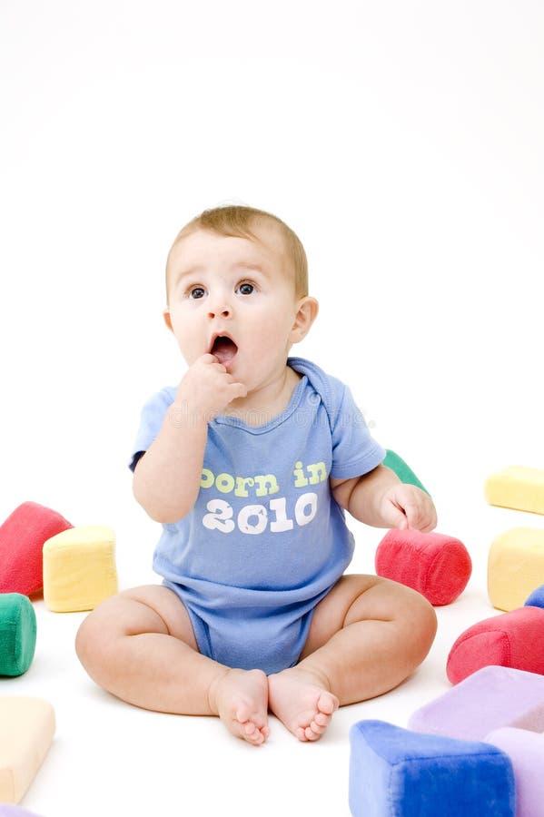 Download Bebê bonito com brinquedos imagem de stock. Imagem de meses - 16864297