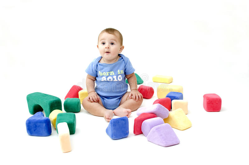 Download Bebê bonito com brinquedos foto de stock. Imagem de vermelho - 16864308