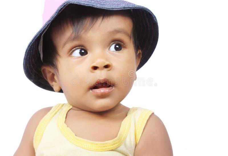 Bebê bonito da menina que olha acima imagens de stock royalty free