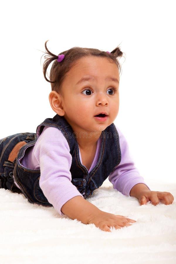 Bebê bonito da raça misturada surpreendido fotos de stock