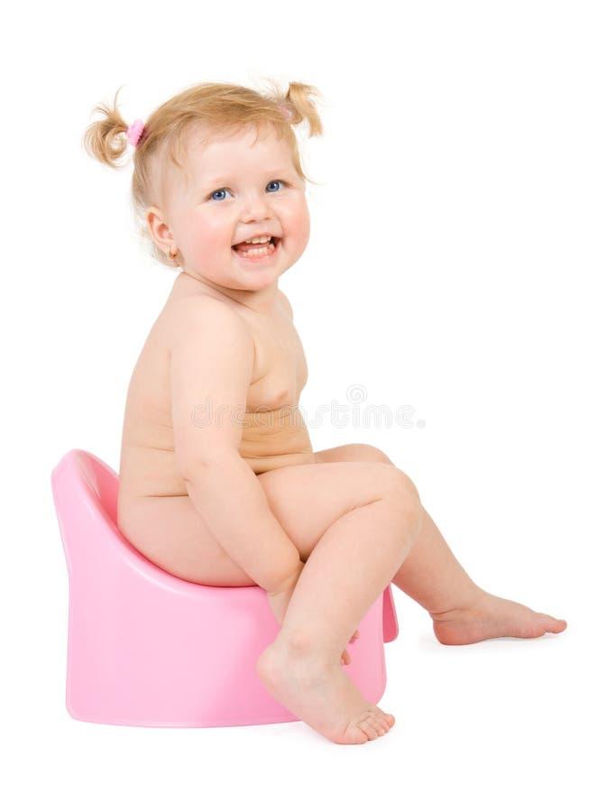 Bebê bonito e potty cor-de-rosa fotos de stock royalty free