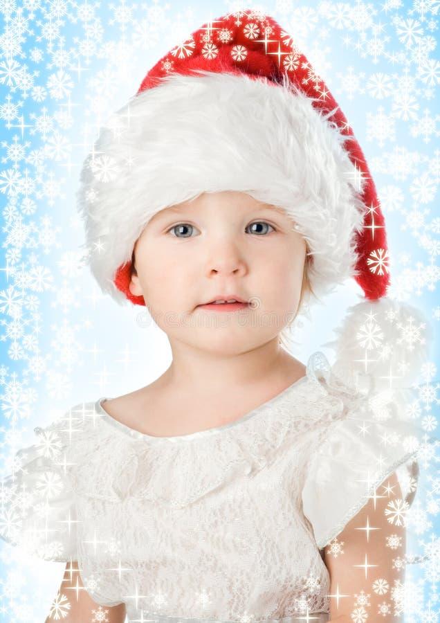Bebê bonito no chapéu do vermelho do Natal de Papai Noel foto de stock royalty free